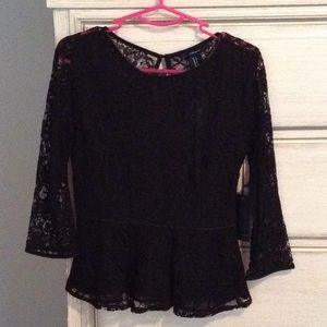 Sheer lace peplum top with faux leather ribbing